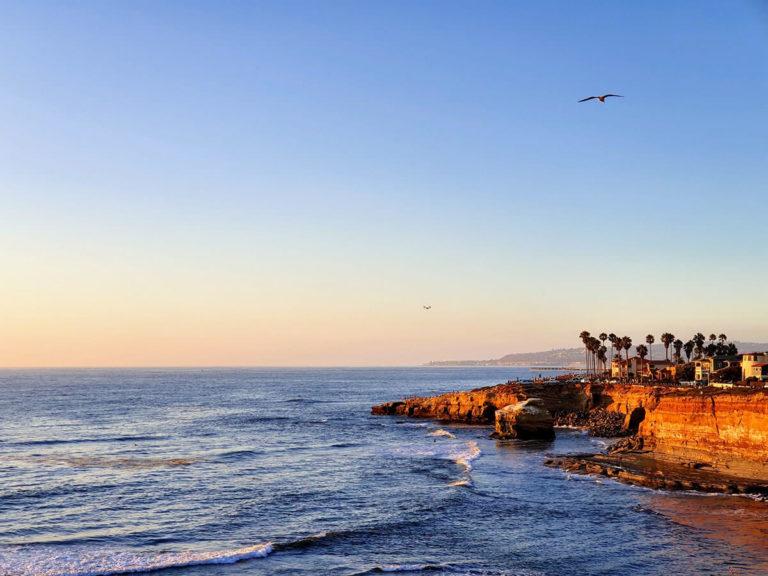 Locations in San Diego with San Diego beach and cliff rocks